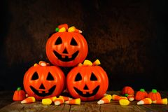 Halloween Jack-o-Lantern candy holders with orange and black background Stock Photos