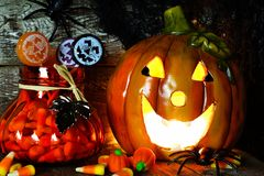 Halloween Jack o Lantern and candy, night scene Stock Photo