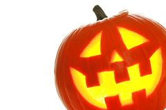 Halloween Jack o Lantern over white, close up in corner Royalty Free Stock Photography
