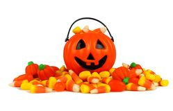 Halloween Jack-o-Lantern pail with a pile of candy over white Royalty Free Stock Photography