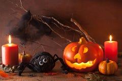 Halloween Jack O Lantern pumpkin decoration spiders candles Royalty Free Stock Photo