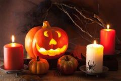 Halloween Jack O Lantern pumpkin decoration spiders candles Stock Photo