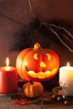 Halloween Jack O Lantern pumpkin decoration spiders candles Royalty Free Stock Photos