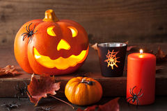Halloween Jack O Lantern pumpkin spiders candles Stock Photo