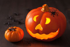 Halloween Jack O Lantern pumpkin spiders candles Royalty Free Stock Images