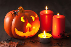 Halloween Jack O Lantern pumpkin spiders candles Stock Photography
