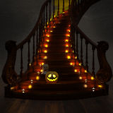 Halloween Jack-O-Lantern Pumpkin on the stairs. High resolution. Royalty Free Stock Photos