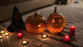 Halloween jack-o-lantern pumpkins. Home decorated with traditional Halloween symbols. stock video footage