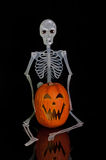 Halloween Jack O Lantern and Skeleton Royalty Free Stock Image