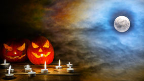 Halloween jack-o-lantern on the terrifying midnight sky with ful Royalty Free Stock Images