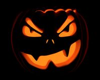 Halloween Jack O Lanterns. Smiling/grinning, Lit from within on black background Stock Image