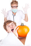 Halloween joke. Screaming young men in bag on deceased and pathologist Royalty Free Stock Photography