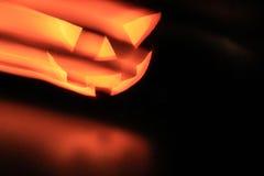 Halloween-Kürbiskopf mit gespenstischen bösen Blicken Lizenzfreie Stockfotografie