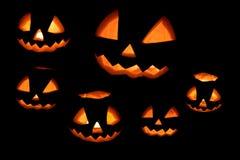 Halloween-Kürbissatz lokalisiert auf einem Schwarzen Stockfotografie