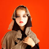 Halloween kid girl costume on orange Stock Photo