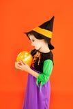 Halloween kid girl costume on orange Stock Image