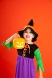 Halloween kid girl costume on orange Stock Photo