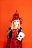 Halloween kid girl costume on orange Royalty Free Stock Photography