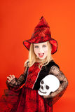 Halloween kid girl costume on orange Stock Images