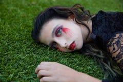 Halloween kid girl custome bloody makeup Stock Image