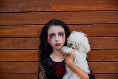 Halloween kid girl custome bloody makeup Stock Photos