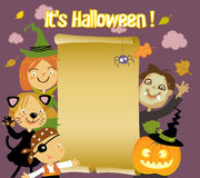 Halloween Kids. Kids in Halloween costumes with paper scroll banner Stock Photos