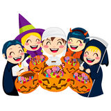 Halloween Kids and Candy. Five kids doing Halloween Trick or Treat holding pumpkin bags full of candy isolated on white background Stock Image