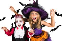 Halloween kids, Happy scary girl and boy dressed up in halloween costumes of witch, sorcerer and vampire Dracula for pumpkin patch royalty free stock photo