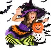 Halloween kids, Happy scary girl dressed up in halloween costumes of witch, sorcerer and vampire Dracula for pumpkin patch. Portrait of a Halloween kids, Happy royalty free stock photography
