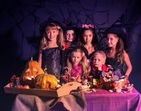 Halloween kids holding carved pumpkin . Stock Images
