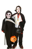 Halloween Kids - Monsters. Two boys dressed as monsters for Halloween.  Full body isolated on white Stock Images