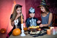 Halloween kids party with candies stock photography