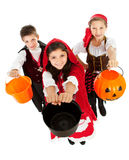Halloween: Kids Ready for Candy. Halloween series with cute children dressed as Dracula, a pirate, and Little Red Riding Hood.  Isolated on white Stock Photo