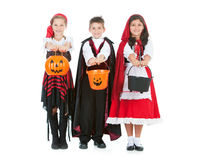Halloween: Kids Ready for Halloween Candy. Halloween series with cute children dressed as Dracula, a pirate, and Little Red Riding Hood.  Isolated on white Stock Images