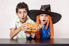 Halloween kids scary expression pumpkin Stock Photography