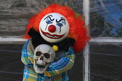 Halloween Killer Clown Doll. Typical Halloween Decorative Doll of Scary, Creepy, Character dolls Clown Killer in front of old house window cover by spider web royalty free stock photos