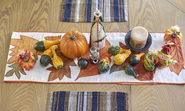 Halloween table decor. Halloween kitchen table decor showing witch, pumpkins, gourds Royalty Free Stock Photo