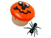 Halloween-kleiner Kuchen und Gummi-Ameise Stockbilder