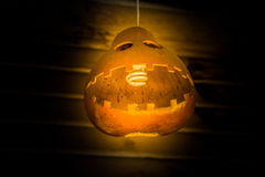Halloween lamp made from dry bottle gourd . Stock Image