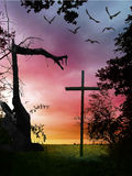 Halloween landcape with cross and broken tree Royalty Free Stock Photos