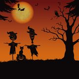 Halloween landscape, scarecrows and pumpkin Stock Photos