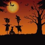 Halloween landscape, scarecrows and pumpkin Stock Photos