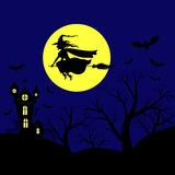 Halloween landscape with witch flying in sky Royalty Free Stock Image