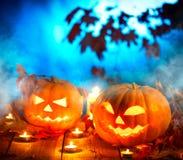 Halloween-lantaarn van de pompoen de hoofdhefboom met het branden van kaarsen Royalty-vrije Stock Foto