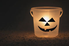 Halloween lantern by bucket in the dark Stock Photo