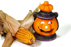 Halloween Lantern and Corn. Happy Halloween pumpkin lantern with scary face Stock Image