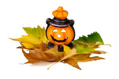 Halloween Lantern with Leafs. Happy Halloween pumpkin lantern with scary face Stock Photo