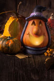Halloween lantern and pumpkins on wooden background Stock Photography
