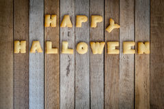Halloween letters of bread on the wooden floor . Stock Image