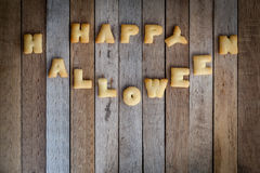 Halloween letters of bread on the wooden floor . Royalty Free Stock Photography